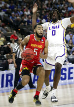 Maryland's Eric Ayala (5) drives around LSU's Naz Reid (0) during the first half of a second-round game in the NCAA men's college basketball tournament in Jacksonville, Fla., Saturday, March 23, 2019. (AP Photo/John Raoux)
