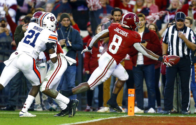 Alabama running back Josh Jacobs (8) carries the ball in for a touchdown against Auburn during the second half of an NCAA college football game, Saturday, Nov. 24, 2018, in Tuscaloosa, Ala. (AP Photo/Butch Dill)