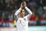Portugal's Cristiano Ronaldo celebrates his team's 2-0 victory at the end of the Euro 2020 group B qualifying soccer match between Luxembourg and Portugal at the Josy Barthel stadium in Luxembourg, Sunday, Nov. 17, 2019. (AP Photo/Francisco Seco)