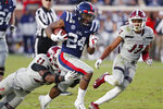 Mississippi running back Snoop Conner (24) runs through the hands of New Mexico State linebacker Rashie Hodge Jr. (23) on his way to a first down during the second half of an NCAA college football game in Oxford, Miss., Saturday, Nov. 9, 2019. Mississippi won 41-3. (AP Photo/Rogelio V. Solis)
