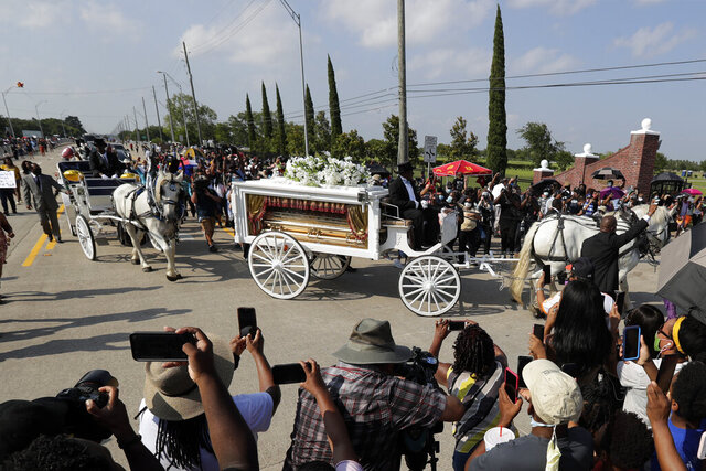 George Floyd's funeral procession arrives at Houston Memorial Gardens cemetery, Tuesday, June 9, 2020, in Pearland, Texas. (AP Photo/Eric Gay)