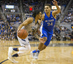 Nevada guard Jazz Johnson (22) drives the baseline against Air Force forward Ryan Swan (34) during the first half of an NCAA college basketball game in Reno, Nev., Saturday, Jan. 19, 2019. (AP Photo/Tom R. Smedes)