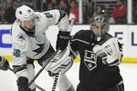 Los Angeles Kings goaltender Jonathan Quick, right, makes a glove save on a shot by San Jose Sharks center Melker Karlsson during the third period of an NHL hockey game Thursday, March 21, 2019, in Los Angeles. The Kings won 4-2. (AP Photo/Mark J. Terrill)