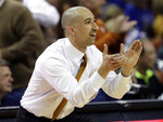 FILE - In this Jan. 29, 2019, file photo, Texas head coach Shaka Smart reacts to a play during the second half on the team's NCAA college basketball game against Kansas in Austin, Texas. Smart's four seasons with the Longhorns have produced a national tournament championship and three one-and-done, first-round NBA draft picks. (AP Photo/Eric Gay, File)