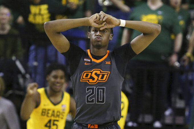 Oklahoma State guard Keylan Boone reacts to a turnover in the second half of the team's NCAA college basketball game against Baylor on Saturday, Feb. 8, 2020, in Waco, Texas. (AP Photo/Rod Aydelotte)