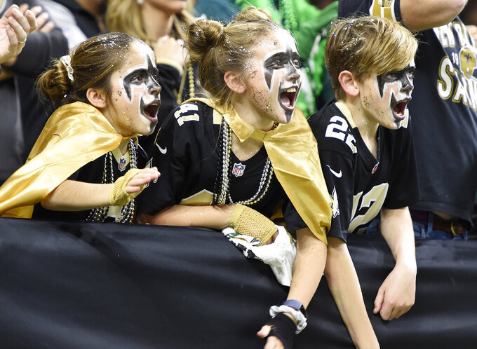 New Orleans Saints fans cheer in the first half of an NFL divisional playoff football game between the New Orleans Saints and the Philadelphia Eagles, in New Orleans, Sunday, Jan. 13, 2019. (AP Photo/Bill Feig)