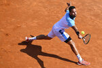 Italy's Salvatore Caruso returns the ball to Serbia's Novak Djokovic, at the Italian Open tennis tournament in Rome, Wednesday, Sept. 16, 2020. (Alfredo Falcone/LaPresse via AP)