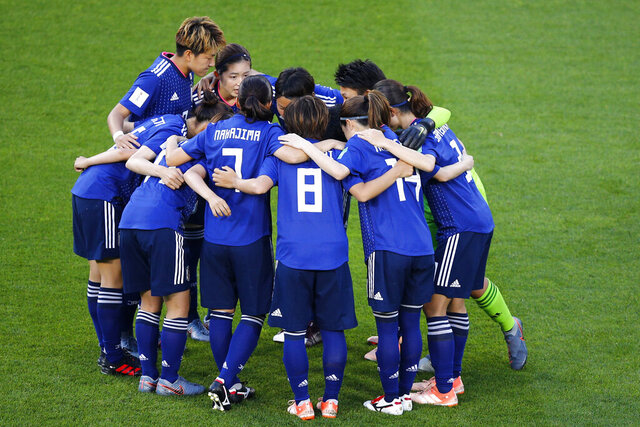 FILE - In this June 25, 2019, file photo,  Japan players embrace ahead of the Women's World Cup round of 16 soccer match between the Netherlands and Japan at Roazhon Park, in Rennes, France. The Japan Football Association is expected to pull out of bidding for the 2023 Women's World Cup, according to a report by Japanese news agency Kyodo on Monday, June 22, 2020.  (AP Photo/Francois Mori, File)