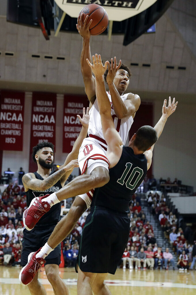Indiana's Rob Phinisee (10) puts up a shot against Portland State's Matt Hauser (10) during the first half of an NCAA college basketball game, Saturday, Nov. 9, 2019, in Bloomington, Ind. (AP Photo/Darron Cummings)