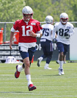 New England Patriots quarterback Tom Brady (12) runs during an NFL football training camp in Foxborough, Mass., Wednesday, June 5, 2019. (AP Photo/Charles Krupa)