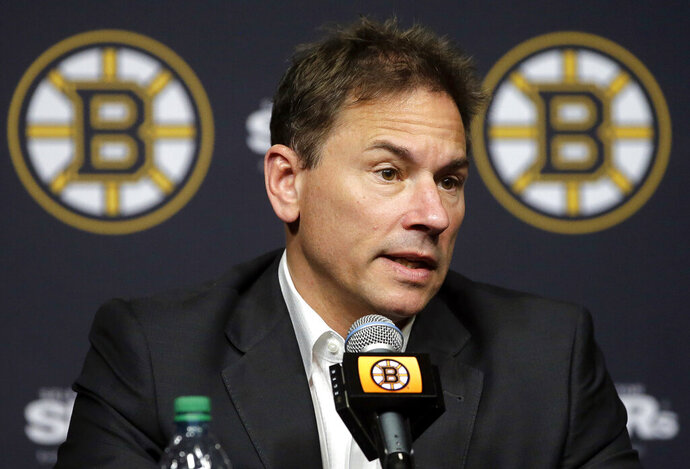 FILE - In this May 10, 2018, file photo, Boston Bruins head coach Bruce Cassidy speaks to reporters during a news conference in Boston. The Boston Bruins have signed coach Bruce Cassidy to a multiyear contract extension, rewarding him for the team's trip to the Stanley Cup Final in just his second full season on the bench. General manager Don Sweeney announced the extension Wednesday, Sept. 11, 2019, a day before training camp begins. (AP Photo/Steven Senne, File)