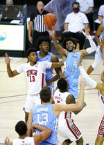 North Carolina guard R.J. Davis (4) leaps to shoot a basket over UNLV guard Bryce Hamilton (13) in the first half of an NCAA college basketball game in the Maui Invitational tournament, Monday, Nov. 30, 2020, in Asheville, N.C. (AP Photo/Kathy Kmonicek)