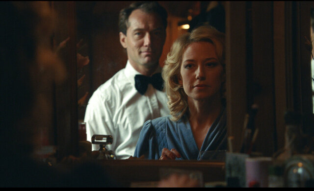 This image released by IFC Films shows Jude Law, left, and Carrie Coon in a scene from