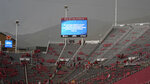 Fans clears the stands at Rice-Eccles Stadium during a delay due to inclement weather during the first half of an NCAA college football game between Weber State and Utah on Thursday, Sept. 2, 2021, in Salt Lake City. (AP Photo/Rick Bowmer)
