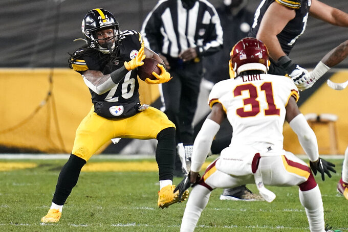 Pittsburgh Steelers running back Anthony McFarland (26) carries the ball with Washington Football Team strong safety Kamren Curl (31) defending during the second half of an NFL football game, Monday, Dec. 7, 2020, in Pittsburgh. (AP Photo/Keith Srakocic)