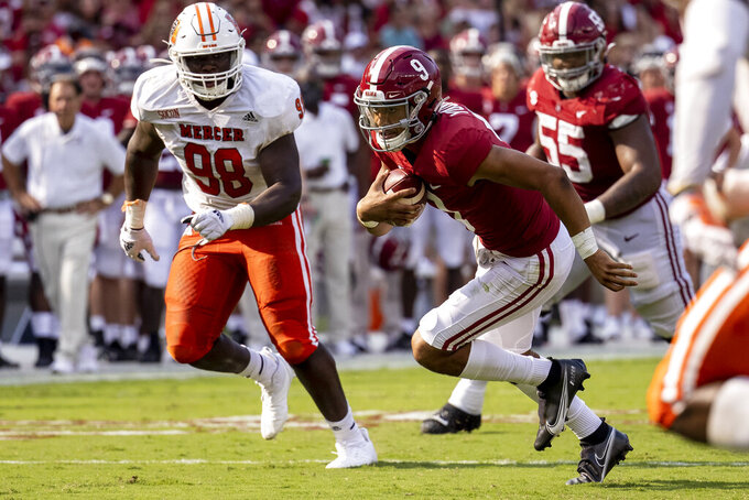 Alabama quarterback Bryce Young (9) runs against Mercer during the first half of an NCAA college football game, Saturday, Sept. 11, 2021, in Tuscaloosa, Ala. (AP Photo/Vasha Hunt)