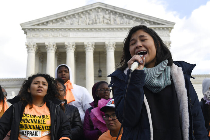 Michelle Lainez, 17, originally from El Salvador but now living in Gaithersburg, Md., speaks during a rally outside the Supreme Court in Washington, Friday, Nov. 8, 2019. The Supreme Court on Tuesday takes up the Trump administration's plan to end legal protections that shield nearly 700,000 immigrants from deportation, in a case with strong political overtones amid the 2020 presidential election campaign. (AP Photo/Susan Walsh)