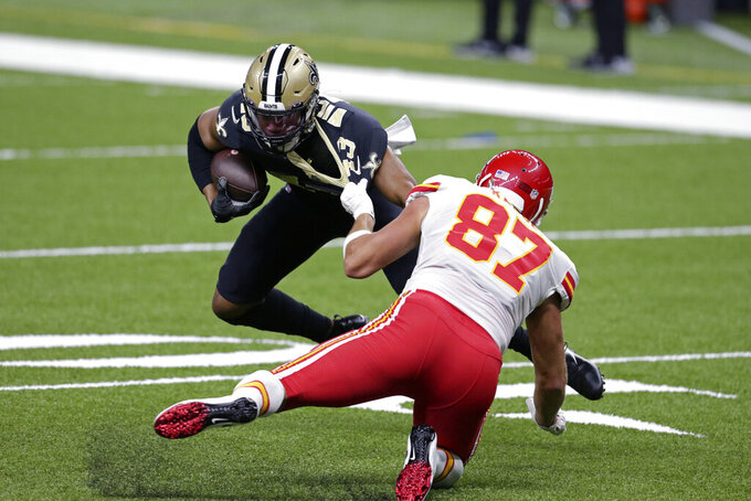 Kansas City Chiefs tight end Travis Kelce (87) tries to tackle New Orleans Saints free safety Marcus Williams (43) as he returns an interception, which was called back due to a defensive penalty, in the first half of an NFL football game in New Orleans, Sunday, Dec. 20, 2020. (AP Photo/Butch Dill)