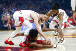 Cleveland Cavaliers' Collin Sexton, bottom, battles Chicago Bulls' Zach LaVine, left, and Coby White, right, for the ball in the first half of an NBA basketball game, Saturday, Jan. 25, 2020, in Cleveland. (AP Photo/Ron Schwane)