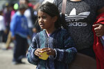 A Central American immigrant family stands in line for food at a sheltered in Piedras Negras, Mexico, Tuesday, Feb. 5, 2019. A caravan of about 1,600 Central American migrants camped Tuesday in the Mexican border city of Piedras Negras, just west of Eagle Pass, Texas. The governor of the northern state of Coahuila described the migrants as