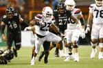 Arizona running back Gary Brightwell (23) runs through the Hawaii defense during an NCAA college football game, Saturday, Aug. 24, 2019, in Honolulu. (AP Photo/Marco Garcia)