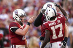 Oklahoma quarterback Spencer Rattler (7) points to Oklahoma tight end Austin Stogner (18) after Stogner's touchdown catch during an NCAA college football game, Saturday, Sept. 25, 2021, in Norman, Okla. (Ian Maule/Tulsa World via AP)