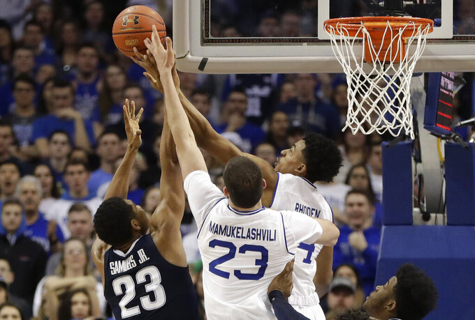 Seton Hall guard Jared Rhoden (14) and forward Sandro Mamukelashvili (23) tip the ball away from Villanova forward Jermaine Samuels (23) during the second half of an NCAA college basketball game, Saturday, March 9, 2019, in Newark, N.J. Seton Hall defeated Villanova 79-75. (AP Photo/Kathy Willens)