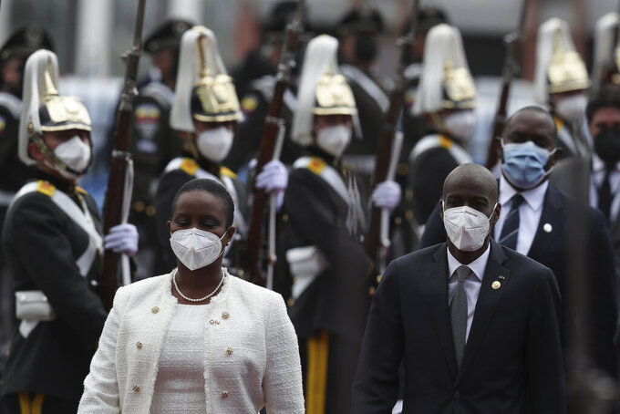 Haiti President Jovenel Moise and his wife First Lady Martine Moise arrive for the inauguration of President-elect Guillermo Lasso at the National Assembly in Quito, Ecuador, Monday, May 24, 2021. (AP Photo/Dolores Ochoa)