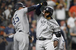 New York Yankees' Gary Sanchez, right, celebrates his three-run home run with Luke Voit (45) during the ninth inning of a baseball game against the Baltimore Orioles, Monday, May 20, 2019, in Baltimore. (AP Photo/Nick Wass)
