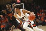 Oregon State's Stephen Thompson, Jr. dribbles past Southern California's Jonah Mathews during the first half of an NCAA college basketball game in Corvallis, Ore., Thursday, Jan. 10, 2019. (AP Photo/Amanda Loman)