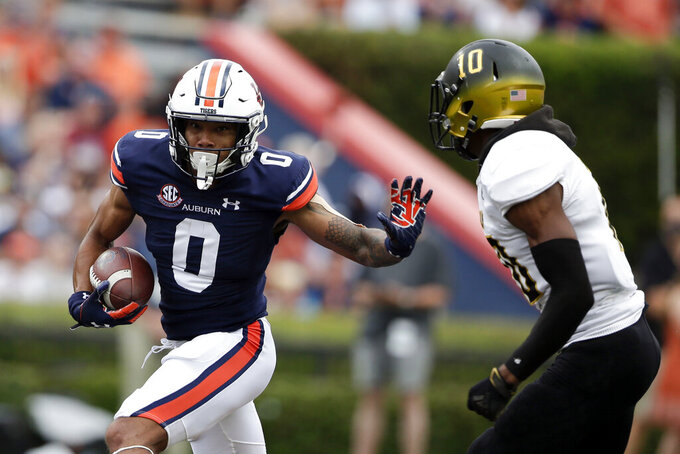 Auburn wide receiver Demetris Robertson (0) tries to get around Alabama State defensive back Keenan Isaac (10) after a reception during the first half of an NCAA football game Saturday, Sept. 11, 2021, in Auburn, Ala. (AP Photo/Butch Dill)