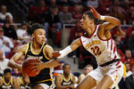 Southern Mississippi guard Auston Leslie looks to pass around Iowa State guard Tyrese Haliburton, right, during the second half of an NCAA college basketball game, Tuesday, Nov. 19, 2019, in Ames, Iowa. Iowa State won 73-45. (AP Photo/Charlie Neibergall)