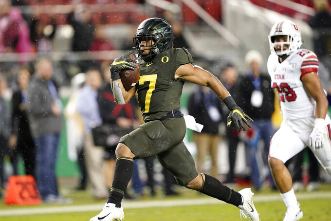 Oregon running back CJ Verdell (7) rushes for a touchdown past Utah defensive back Javelin Guidry (28) during the second half of an NCAA college football game for the Pac-12 Conference championship in Santa Clara, Calif., Friday, Dec. 6, 2018. Oregon won 37-15. (AP Photo/Tony Avelar)