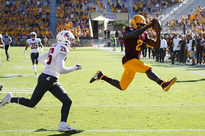 Arizona State wide receiver Brandon Aiyuk (2) leaps to the end zone for a touchdown beating Washington State safety Bryce Beekman (26) during the second half of an NCAA college football game Saturday, Oct. 12, 2019, in Tempe, Ariz. (AP Photo/Ross D. Franklin)