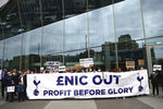 Tottenham fans stage a protest against the Board over the planned creation of a European Super League, outside the Tottenham Hotspur Stadium ahead of the English Premier League football match between Tottenham Hotspur and Southampton in London, England, Wednesday April 21, 2021. (Clive Rose/Pool via AP)