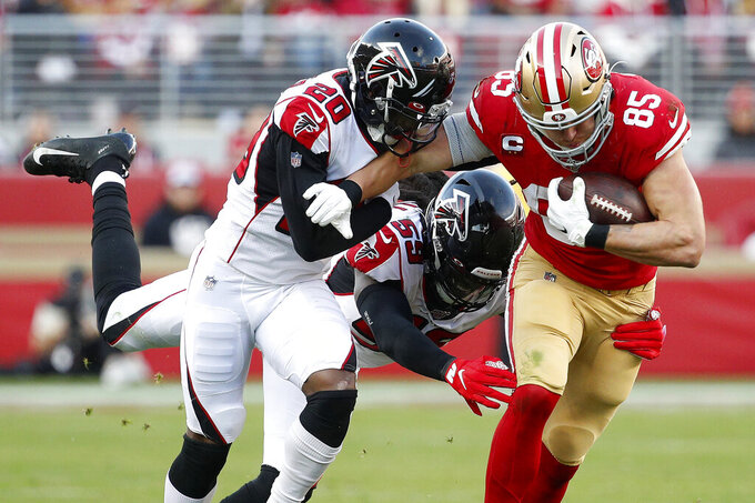San Francisco 49ers tight end George Kittle (85) runs against Atlanta Falcons defensive back Kendall Sheffield (20) and outside linebacker De'Vondre Campbell (59) during the second half of an NFL football game in Santa Clara, Calif., Sunday, Dec. 15, 2019. (AP Photo/Josie Lepe)