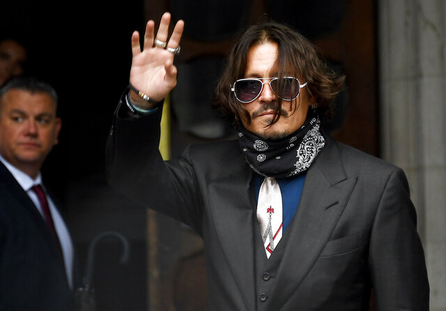 "Johnny Depp arrives at the High Court in London, Wednesday July 8, 2020. Johnny Depp is facing a second day of cross-examination by lawyers for British tabloid The Sun, which is defending a libel claim after calling the Hollywood star a ""wife beater."" Depp is suing The Sun's publisher, News Group Newspapers, and its executive editor, Dan Wootton, over an April 2018 article that said he'd been abusive to ex-wife Amber Heard. (AP Photo/Alberto Pezzali)"