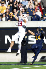 Stanford wide receiver JJ Arcega-Whiteside (19) catches a deep pass as California cornerback Camryn Bynum (24) defends in the second quarter of a football game in Berkeley, Calif., Saturday, Dec. 1, 2018. (AP Photo/John Hefti)
