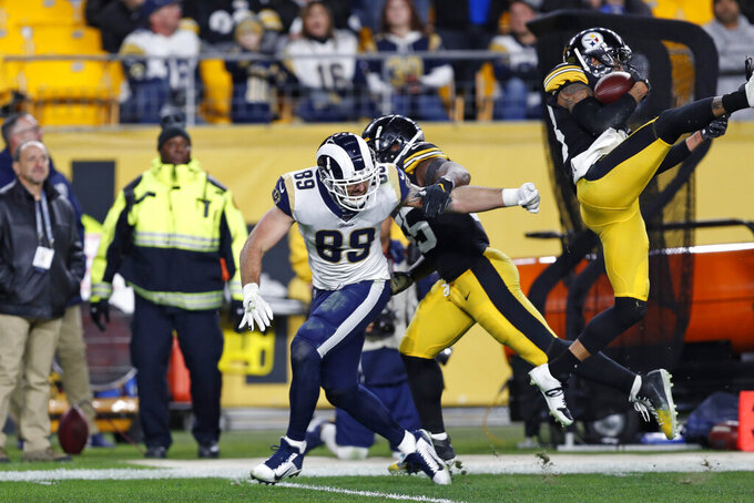Pittsburgh Steelers cornerback Joe Haden, right, intercepts a pass intended for Los Angeles Rams tight end Tyler Higbee (89) during the second half of an NFL football game in Pittsburgh, Sunday, Nov. 10, 2019. (AP Photo/Keith Srakocic)
