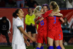U.S. players, including Megan Rapinoe, facing camera, and Julie Ertz, left, celebrate after a goal by midfielder Samantha Mewis (3) during the first half of a CONCACAF women's Olympic qualifying soccer match against Mexico on Friday, Feb. 7, 2020, in Carson, Calif. (AP Photo/Chris Carlson)