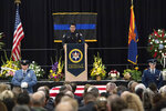 Family friend Ulrich Zamora speaks at the Tucson Convention Center in Tucson, Ariz., for the Celebration of Life ceremony for fallen U.S. Marshal Deputy Chase White on Friday, Dec. 7, 2018. White was shot and killed while serving an arrest warrant on Nov. 29. (Shane T. McCoy/U.S. Marshals Service via AP)