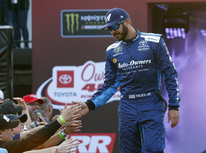 Martin Truex Jr. greets fans prior before the NASCAR Cup Series auto race at Richmond Raceway in Richmond, Va., Saturday, April 13, 2019. (AP Photo/Steve Helber)