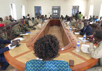 In this photo dated Thursday, Jan. 1 2019, Government and opposition forces come together for one of many meetings aimed at building confidence for a peace deal between the opposing forces, in the town of Yambio, South Sudan, although the meeting deteriorated with both sides accused of recruiting forces and using child soldiers. Officials sad Thursday Feb. 21 2019, that evidence from numerous accounts, suggest that South Sudan's rival armed groups are forcefully recruiting civilians, including child soldiers, violating a fragile peace deal signed five months ago.  (AP Photo/Sam Mednick)