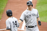 New York Yankees' DJ LeMahieu, right, is greeted by Tyler Wade (14) after they both scored a single by Brett Gardner during the third inning of the first baseball game of a doubleheader against the Baltimore Orioles, Friday, Sept. 4, 2020, in Baltimore. (AP Photo/Nick Wass)