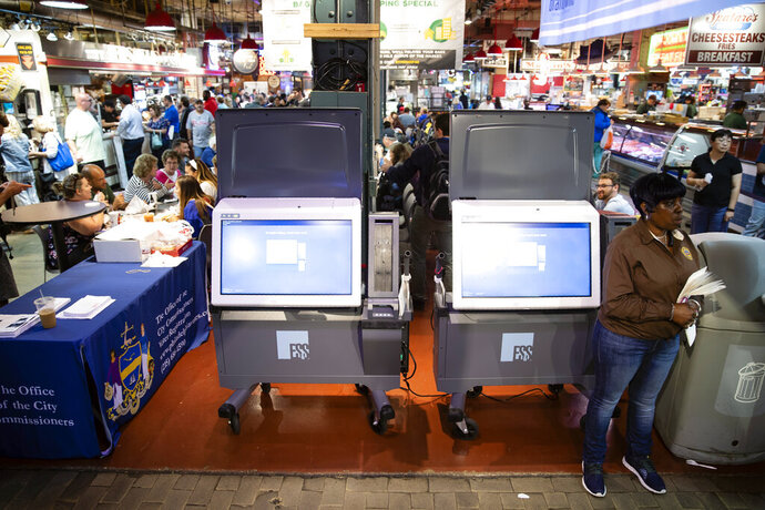 FILE - In this June 13, 2019, file photo, ExpressVote XL voting machines are displayed during a demonstration at the Reading Terminal Market in Philadelphia. More than one in ten voters could vote on paperless voting machines in the 2020 general election, according to a new analysis, leaving their ballots vulnerable to hacking according to a new study. (AP Photo/Matt Rourke, File)