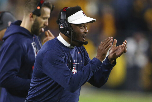 Arizona coach Kevin Sumlin claps in support of his team's defense against Arizona State during the first half of an NCAA college football game, Saturday, Nov. 30, 2019, in Tempe, Ariz. (AP Photo/Darryl Webb)