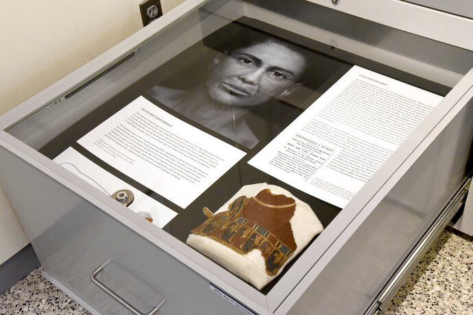 In a Sept. 26, 2018 photo, a pull-out drawers offer more information about the facial depiction process at the new Johns Hopkins Archaeological Museum exhibit,