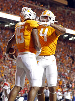Tennessee wide receiver Jauan Jennings (15) celebrates a touchdown with teammate tight end Dominick Wood-Anderson (4) in the first half of an NCAA college football game against Georgia, Saturday, Oct. 5, 2019, in Knoxville, Tenn. (AP Photo/Wade Payne)