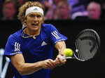 Team Europe's Alexander Zverev hits a return to Team World's Kevin Anderson during a men's singles tennis match at the Laver Cup, Sunday, Sept. 23, 2018, in Chicago. (AP Photo/Jim Young)