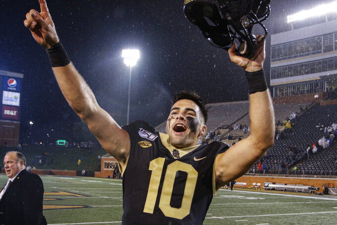 Wake Forest quarterback Sam Hartman celebrates after Wake Forest defeated Florida State 22-20 in an NCAA college football game, in Winston-Salem, N.C., Saturday, Oct. 19, 2019. (AP Photo/Nell Redmond)